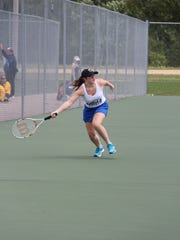 Assumption's No. 1 singles player Jadelyn Hunn stretches out to hit a forehand shot during a recent Royals match.