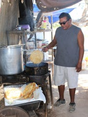 Mick Washington makes fry bread at The Stand, located