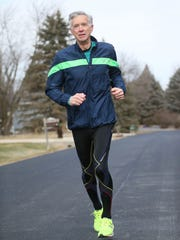 Bill Lamers of the Town of Lisbon runs near his home in February. He's preparing for the PNC Milwaukee Marathon..