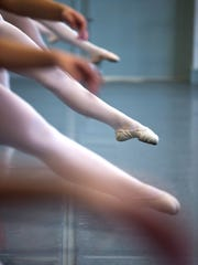 Dancers practice barre exercises during a technique class on Monday, September 25, 2017 at the Naples Academy of Ballet in Naples.