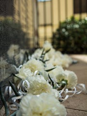 Friends and family laid flowers at the base of the