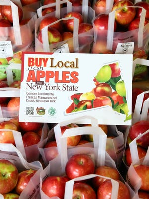 Acme's produce section features apples grown nearby at the orchards of Hudson River Fruit Distributors in New York State.
