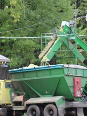 Within Wisconsin, a land area equivalent to that of Dane County has been converted to uses other than agricultural production during the past generation. Sweet corn waste is emptied into a wagon at a canning plant in Lodi, WI.