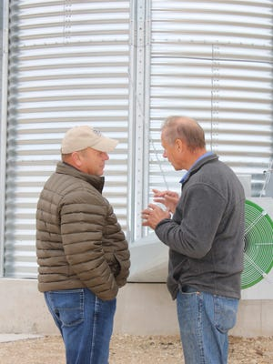 Wisconsin Farm Bureau Federation President Jim Holte (right) speaks to American Farm Bureau Federation President Zippy Duvall during his visit to Soaring Eagle Dairy in Manitowoc County in 2017. Holte will step down as president in December.