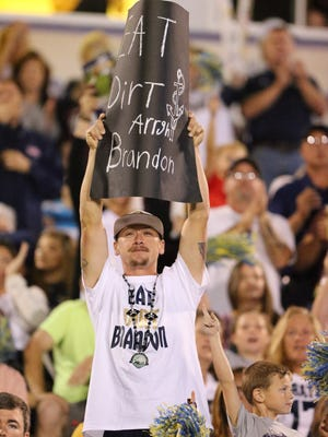 A Pearl fan holds a sign during the rivalrly game beween Brandon and Pearl on Friday, November 4, 2016. Photo by Keith Warren