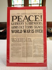 An Asheville Citizen headline on display inside the Dorland Memorial Presbyterian Church during the centennial commemoration of the WWI German internment camp in Hot Springs trumpets the end of WWI.