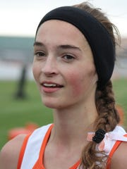 Div. 1 girls winner: Ericka VanderLende, Rockford junior