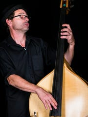 Upright bassist Julio Pintos performs with The Woodwork