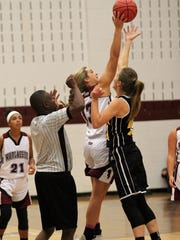 Chesney Gardner controls the tip off for the Warlassies in a Nov. 9 scrimmage at home against Tuscola.