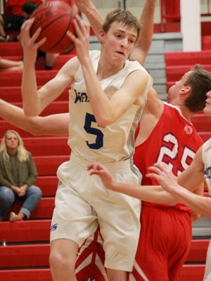 Cotter's Trenton Tardiff rebounds against Melbourne on Wednesday night at Flippin.