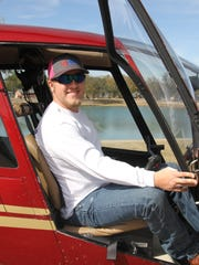 """Espejo Helicopters pilot and Carlsbad native Caleb Wade will fly a helicopter for """"Christmas over Carlsbad,"""" which offers air tours over the Pecos River and the city, beginning Nov. 24, 2017."""