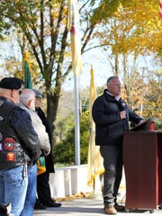 MVMC Chairman and Marine Corps veteran Mike Maloney making opening remarks flanked by (from left) Vietnam veteran (U.S. Navy) and Rolling Thunder Rep. Joseph Kotch, who was the guest speaker; former Mayor Donald Matthews (MVMC); and Navy veteran and master of ceremonies Peter Rayner (MVMC).