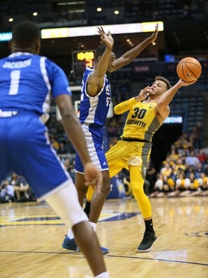Marquette's Andrew Rowsey gets fouled while attempting a three-pointer against Eastern Illinois on Monday.