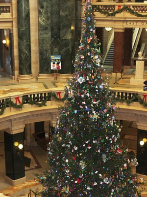 The 40-foot tall balsam fir from Price County is decorated with hundreds of ornaments donated by school children from across the state in honor of the capitol building's centennial anniversary.