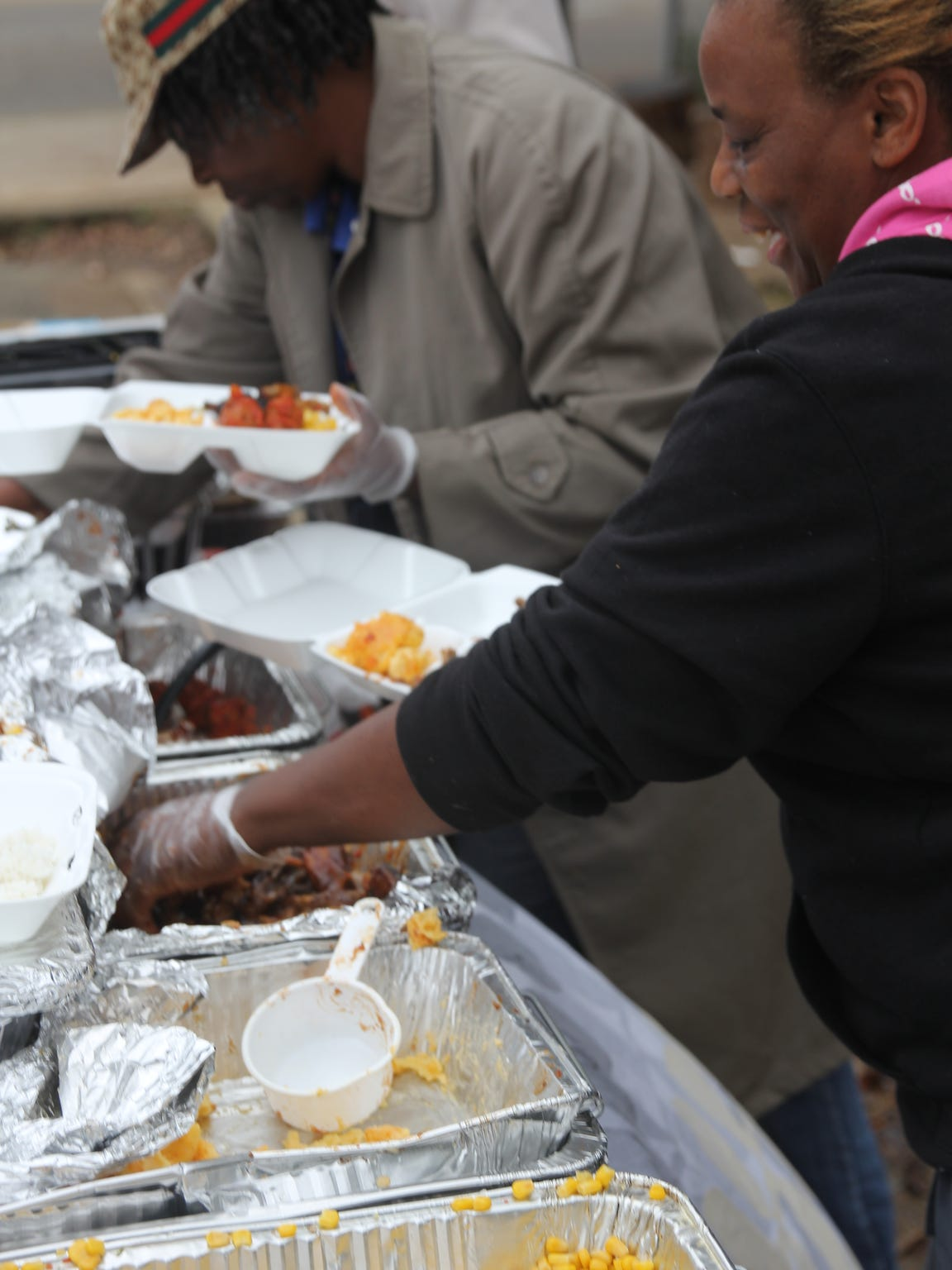 Vanessa Henry, in pink, and Petra Perry hand out hot meals in Tallahassee's Frenchtown.