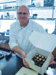 Konrad Spitzbart, executive pastry chef at The Peabody hotel, displays a box of Christmas candy suitable for making at home.