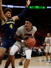 Former Wolverine Kameron Chatman, right, leads Detroit Mercy with 17.5 points and 8.8 rebounds per game.