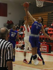 Loving Falcons senior Kevin Martinez goes for a rebound during the first quarter of Monday's game against the Carlsbad Cavemen JV team, Jan. 22, 2018. The Falcons loss 51-59 to the Cavemen
