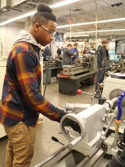Julian Cornwall, 17, has 12 job offers to mull over as he considers his future. He likes working with his hands, and still wants to pursue college. A career tech program is helping him reach that goal and may help the manufacturing industry bridge the skills gap.
