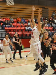 Junior Chasity Onsurez goes for a rebound during Saturday's