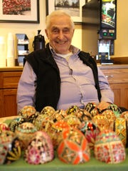 Ray Good shows off some of his decorated Ukrainian eggs.