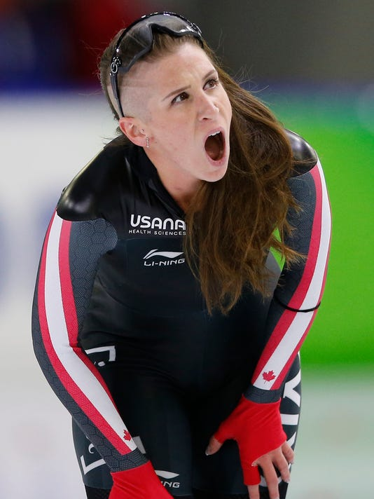 FILE - In this Sunday Nov. 12, 2017 file photo, Canada's Ivanie Blondin catches her breath after competing in the women's 3,000 meter race of the Speedskating World Cup at the Thialf ice rink in Heerenveen, Netherlands. With all skaters chasing in a pack it can get hairy, said 2016 world champion Blondin of Canada, explaining the attitude going round the oval during the mass start event. (AP Photo/Peter Dejong)