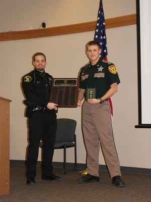 Easton Meier of Beaver Dam, right, is pictured receiving the 2017 Explorer of the Year award from Deputy Dustin Waas, given at the Dodge County Law Enforcement Explorer annual parents/awards night on Jan. 22.
