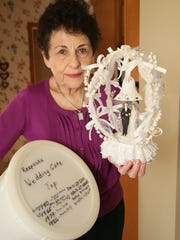 Betty Kasdorf is the keeper of a wedding cake topper