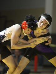 Ryan Cotton (left) of Palm Springs battles Devin Shaw of Shadow Hills in the 138-pound DVL championship match Saturday. Cotton won by pin.