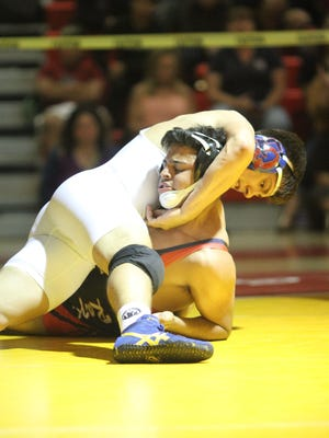 Noel Magallanes of La Quinta competes with Issac Reyes of Indio for the 160 lbs DVL title on Saturday, February 10, 2018 in Palm Desert.