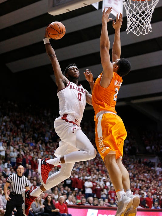 Alabama forward Donta Hall scores against Tennessee forward Grant Williams during the second half of an NCAA college basketball game Saturday, Feb. 10, 2018, in Tuscaloosa, Ala. Alabama won 78-50. (AP Photo/Brynn Anderson)