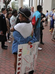 A couple embraces outside of the Florida Capitol Wednesday.