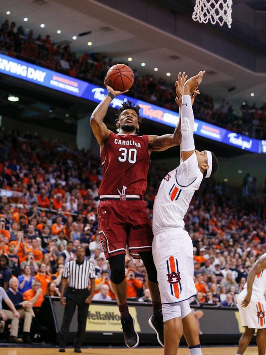 South Carolina forward Chris Silva shoots and scores against Auburn forward Chuma Okeke during the first half of an NCAA college basketball game, Saturday, March 3, 2018, in Auburn, Ala. (AP Photo/Brynn Anderson)