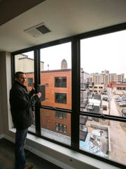 Kent Roers showing top floor apartment view during tour of Flux Apartments on Walnut Street on Tuesday, March 20, 2018, in Des Moines, Iowa.