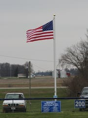 The flag will fly beyond the softball outfield.