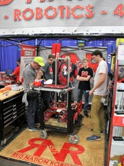 The Red Nation Robotics Team #4576 in the pit at the FIRST® Robotics World Championship in Houston. Adam Schoolfield, Build Team Lead for 2018-19, said they had to take toolboxes, batteries, media items (including banners, backdrops and a trophy case) to the Houston competition.