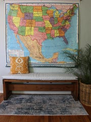 A vintage map anchored the update for an entryway.