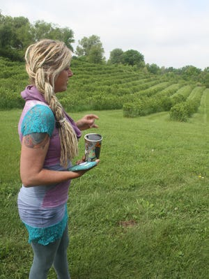 Deda Happel views the aronia berry fields where many receptions she anticipates will take place.