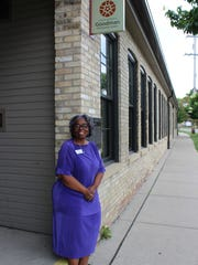 Executive Assistant Edith Hilliard stands outside the door of the historic Goodman Community Center in Madison.