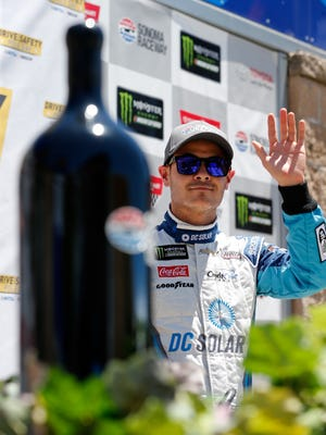 Kyle Larson poses for a photo after winning the pole award during qualifying for the NASCAR Cup Series Toyota/Save Mart 350 at Sonoma Raceway on Saturday.