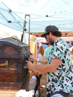 Pouring beer at a recent Monterey Beer Festival.