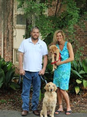 Brian Wimberly with Bella and Karen Minert and her new dog Emma.