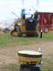 Unmanned tractors built by Farb Guidance Systems can