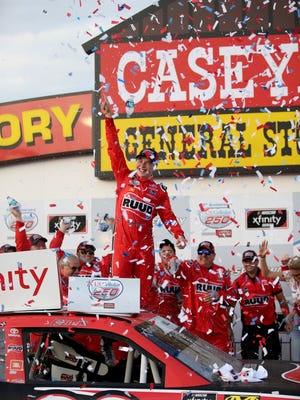 Christopher Bell celebrates in victory lane after winning the NASCAR Xfinity Series race Saturday.