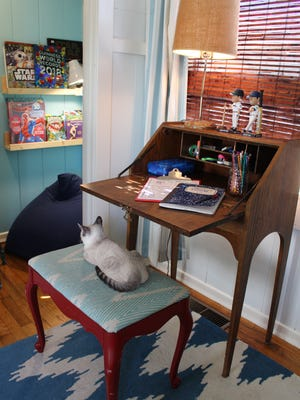 A repurposed vintage desk allows a quiet spot away from the hustle and bustle of the rest of the family for Thomas to complete homework.