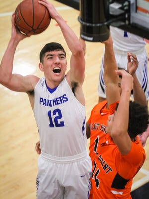 Van Alstyne High School's Sam Tormos gets to the rim during a playoff loss to Pilot Point.