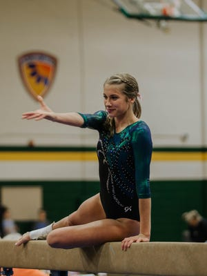 Free State senior Talia Gay bounced back from a back injury that hampered her in 2019 to capture the state all-around title this season. Gay also won titles in the uneven bars and balance beam and led the Firebirds to their first state championship.