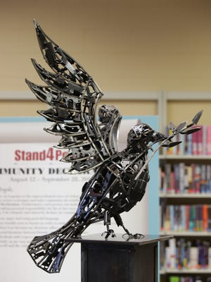 The peace dove sculpture forged from destroyed firearms parts