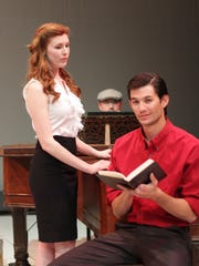 "Aaron Aubrey plays Jamie — a rising star novelist, seen here at a reading event at a major bookstore — with his wife Cathy (Mary McNulty), an aspiring actress looking on in Lost Nation Theater's production of the musical ""The Last 5 Years."""
