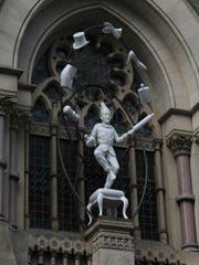 Robert Taplin's 'The Young Punch Juggling' stands outside of the Pennsylvania Academy of the Fine Arts. It is a work of fiberglass and steel.